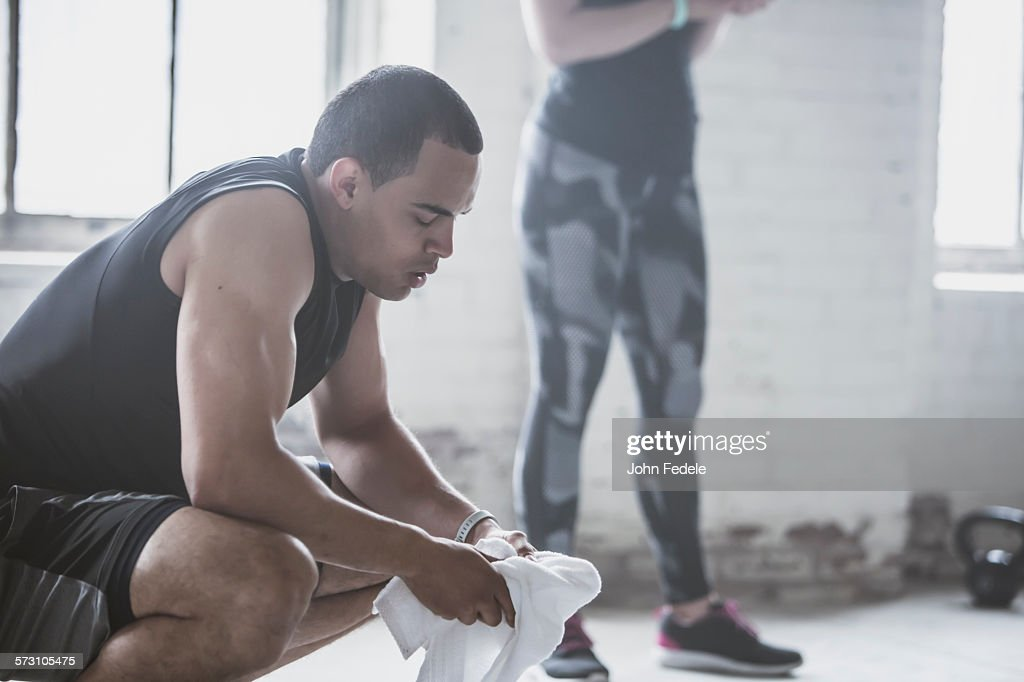 Athletes resting with towel : Stock Photo