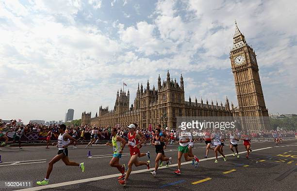 Athletes run along Westminster Bridge next to the Palace of Westminster as they compete in the Men's Marathon on Day 16 of the London 2012 Olympic...