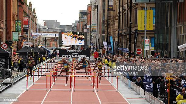 Athletes run during the Great city games in Manchester northwest England on May 16 2010 AFP PHOTO/ANDREW YATES