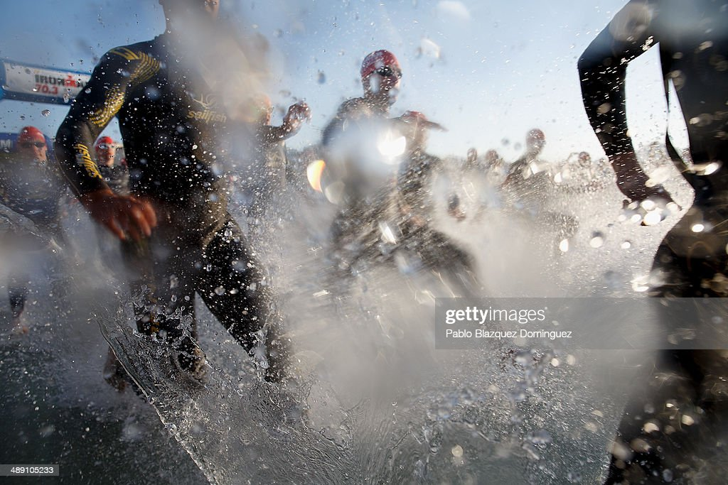 Athletes run into the water at the start of the Ironman 70.3 Mallorca on May 10, 2014 in Mallorca, Spain.
