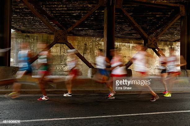 Athletes run through an underpass during the men's marathon on Day 15 of the Toronto 2015 Pan Am Games on July 25 2015 in Toronto Canada