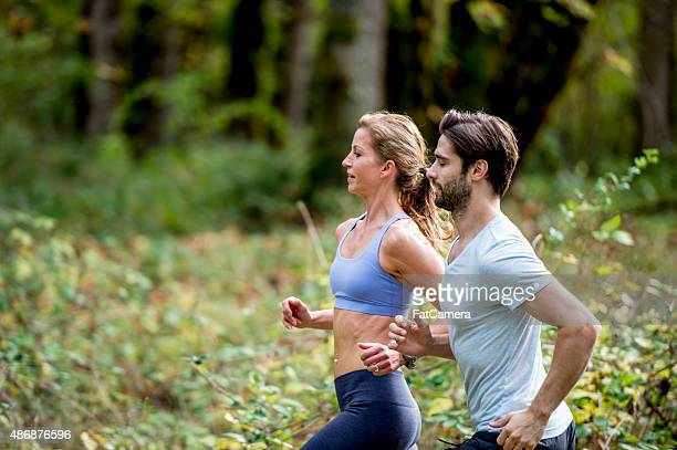 Athletes Running Through the Woods