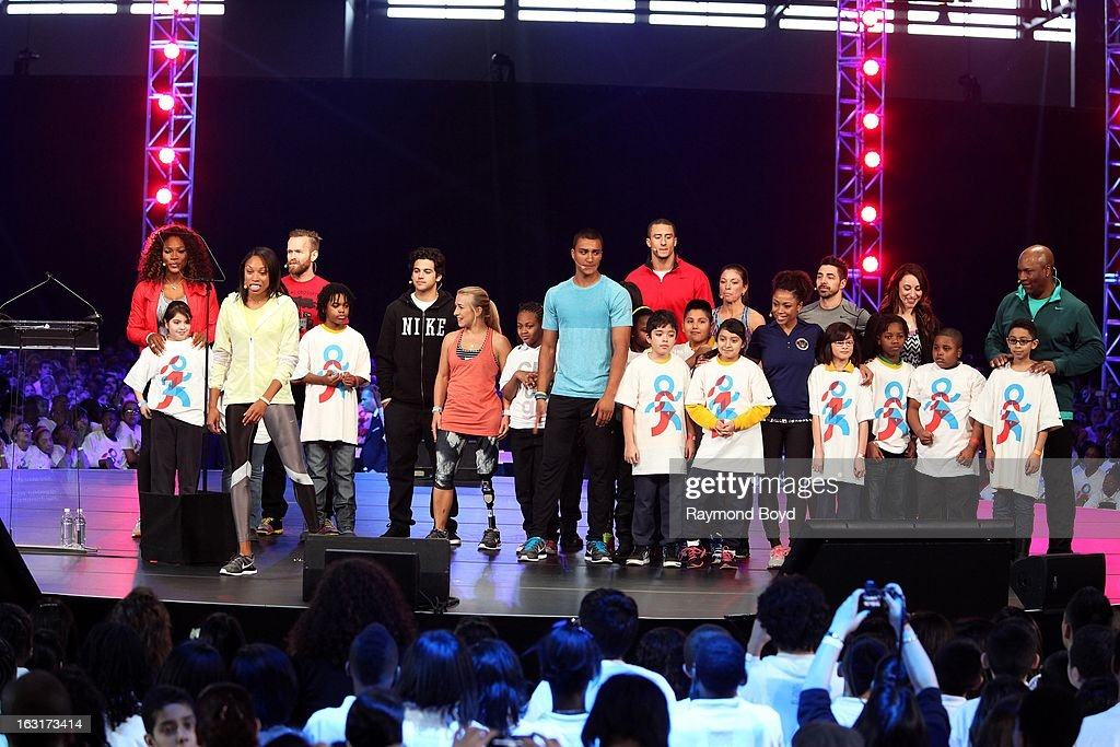 Athletes Serena Williams, Allyson Felix, Bob Harper, Paul Rodriguez, Sarah Reinertsen, Ashton Eaton, Colin Kaepernick, Dominique Dawes and Bo Jackson, joins students on stage during the Third Anniversary Of Let's Move! With First Lady Michelle Obama at McCormick Place in Chicago, Illinois on FEBRUARY