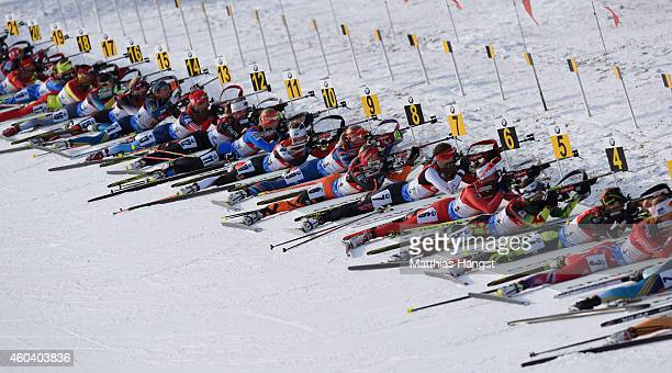 Athletes shoot at the range as they compete during the women 4 x 6 km relay event in the IBU Biathlon World Cup on December 13 2014 in Hochfilzen...