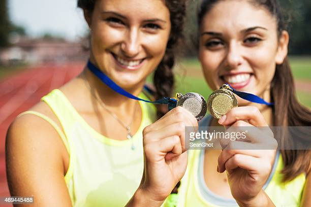 Athletes showing medals