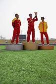 Athletes Standing on Winner s Podium