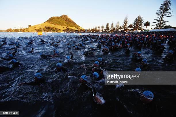 Athletes start in the Elite Men's race during the Port of Tauranga Half Ironman on January 5 2013 in Tauranga New Zealand