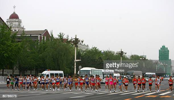 Athletes start in Tiananmen Square during the 'Good Luck Beijing' 2008 Beijing International Marathon Race at on April 20 2008 in Beijing China