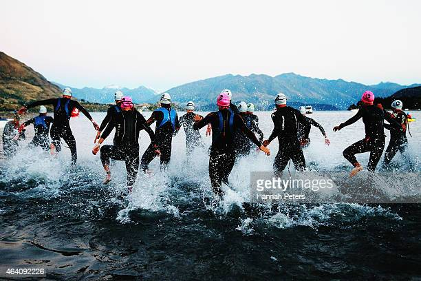 Athletes start the pro race during Challenge Wanaka on February 22 2015 in Wanaka New Zealand