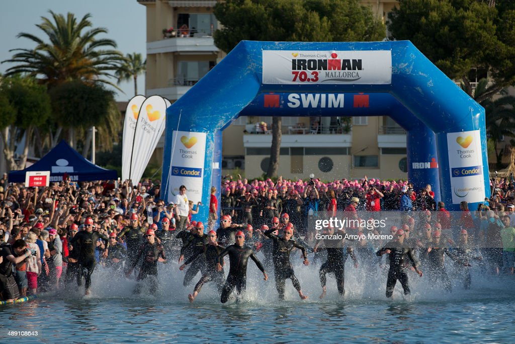 Athletes start the swimming course at Alcudia beach during the Ironman 70.3 Mallorca at Alcudia Bay on May 10, 2014 in Mallorca, Spain.