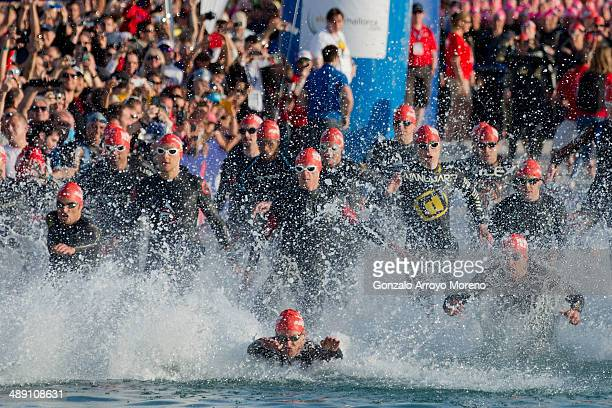 Athletes start the swimming stage at Alcudia beach during the Ironman 703 Mallorca at Alcudia Bay on May 10 2014 in Mallorca Spain