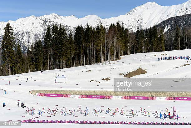 Athletes start the Women's 30 km Mass Start Free during day 15 of the Sochi 2014 Winter Olympics at Laura Crosscountry Ski Biathlon Center on...