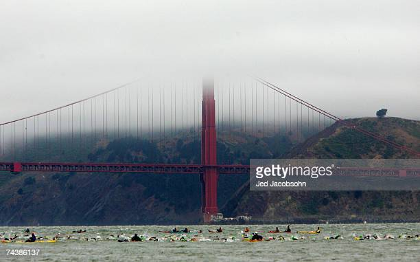 Athletes swim in the San Francisco Bay during the Escape from Alcatraz Triathlon on June 3 2007 in San Francisco California