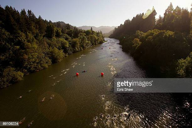 Athletes swim the 12 mile course in the Russian River during the the Vineman Ironman 703 on July 19 2009 in Santa Rosa California 2000 athletes...