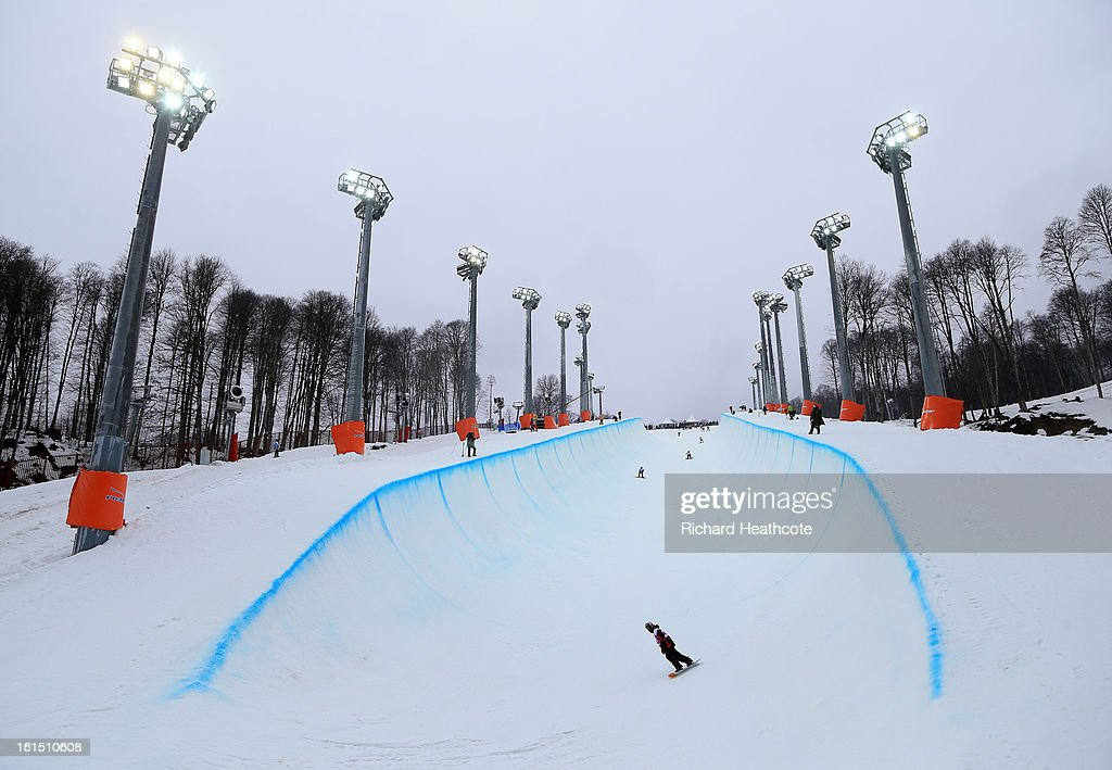 Athletes take part in an open training session on the Snowboard Half Pipe in the Extreme Park up at the Rosa Khutor Alpine Ski Resort on February 12, 2013 in Sochi, Russia. Sochi is preparing for the 2014 Winter Olympics with test events.