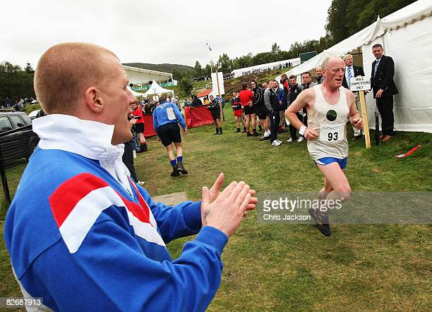 Athletes take part in the traditional hill run during the Annual Braemar Highland Gathering on September 6 2008 in Braemar Scotland The Braemar...
