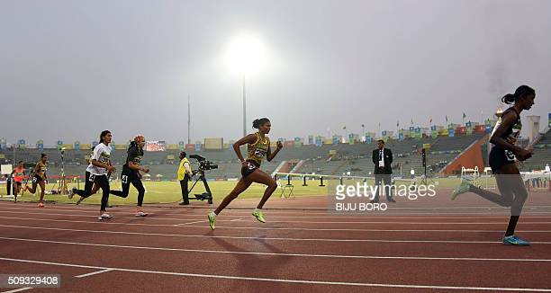 TOPSHOT Athletes take part in the women's 800m event during the 12th South Asian Games 2016 at Indira Gandhi Athletics Stadium in Guwahati on...
