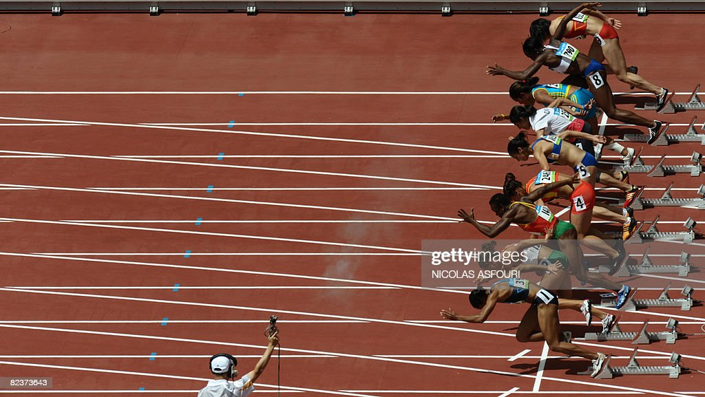 Athletes take the start of the women's 100m heat 1 at the National stadium as part of the 2008 Beijing Olympic Games on August 16, 2008. Torri Edwards of the US won ahead of Britain's Jeanette Kwakye and Cameroon's Myriam Leonie Mani.