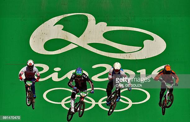 TOPSHOT Athletes train before the BMX cycling seeding phase runs at the XPark BMX venue in Deodoro during the Rio 2016 Olympic Games in Rio de...