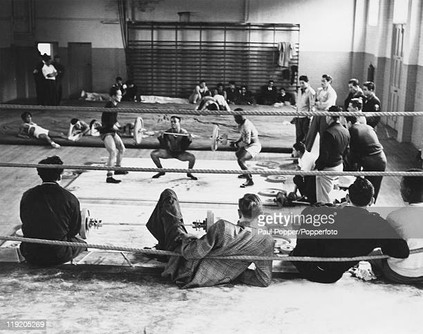 Athletes training with weights at a Richmond gymnasium for the 1948 Summer Olympics in London