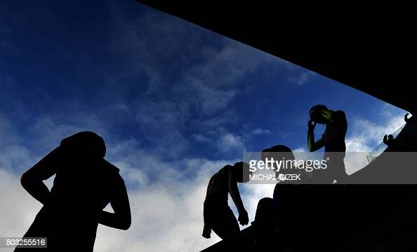 TOPSHOT Athletes wait for their turn during a training session of the Four Hills competition of the FIS Ski Jumping World Cup in Innsbruck on January...