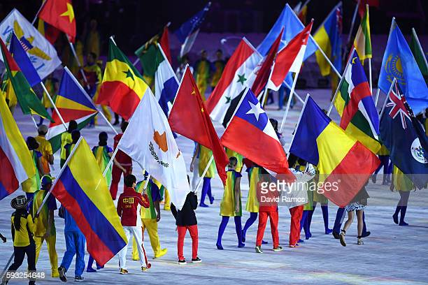 Athletes walk during the 'Heroes of the Games' segment during the Closing Ceremony on Day 16 of the Rio 2016 Olympic Games at Maracana Stadium on...