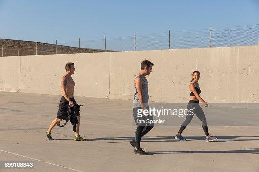 'Athletes walking before workout, Van Nuys, California, USA'