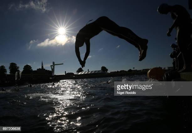 Athletes warm up ahead of the KMD IRONMAN 703 European Championship Elsinore on June 18 2017 in Helsingor Denmark
