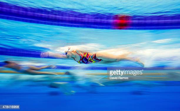 Athletes warm up prior to the start of the morning swimming session on day thirteen of the Baku 2015 European Games at the Baku Aquatics Centre on...