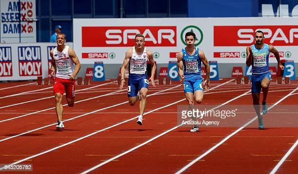 Athlethes including Filippo Tortu of Italy compete in men's 100meter heat during the 23rd European Athletics Championships at the Olympic Stadium in...