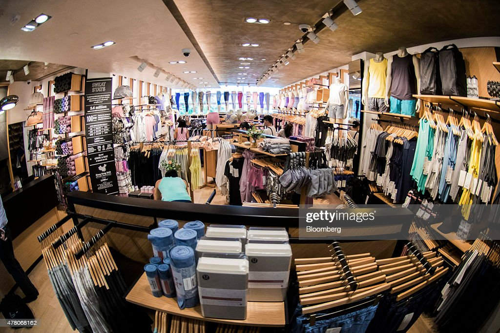 Athletic apparel sits on display in this photograph taken with a fisheye lens inside a Lululemon Athletica Inc store at the International Finance...