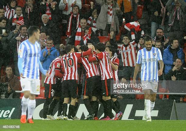 Athletic Bilbao players celebrate after forward Aritz Aduriz scored during the Spanish Copa del Rey quarter final second leg football match Athletic...