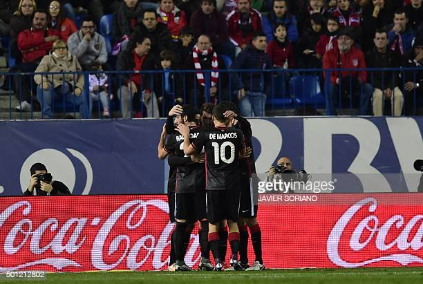 Athletic Bilbao players celebrate after scoring a goal during the Spanish league football match Club Atletico de Madrid vs Athletic Club Bilbao at...