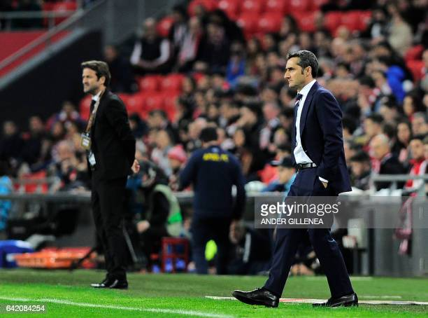 Athletic Bilbao's coach Ernesto Valverde and Apoel's coach Thomas Christiansen stand on the sideline during the Europa League football match Athletic...