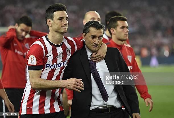 Athletic Bilbao's coach Ernesto Valverde and Athletic Bilbao's forward Aritz Aduriz reacts at the end of the Spanish Copa del Rey final football...