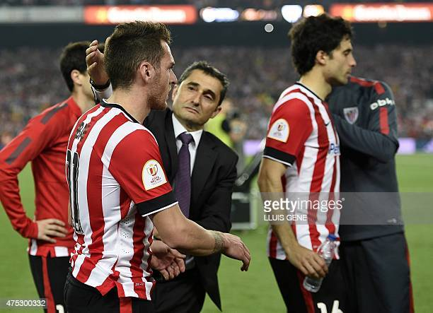 Athletic Bilbao's coach Ernesto Valverde comforts a player at the end of the Spanish Copa del Rey final football match Athletic Club Bilbao vs FC...