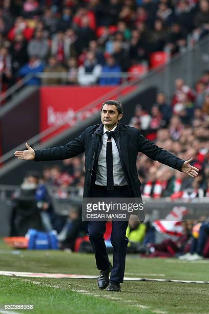 Athletic Bilbao's coach Ernesto Valverde gestures during the Spanish league football match Athletic Club Bilbao vs Club Atletico de Madrid at the San...