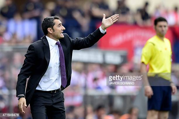 Athletic Bilbao's coach Ernesto Valverde gestures from the sidelines during the Spanish league football match Club Atletico de Madrid vs Athletic...