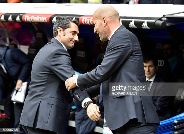 Athletic Bilbao's coach Ernesto Valverde greets Real Madrid's French coach Zinedine Zidane before the Spanish league football match Real Madrid CF vs...
