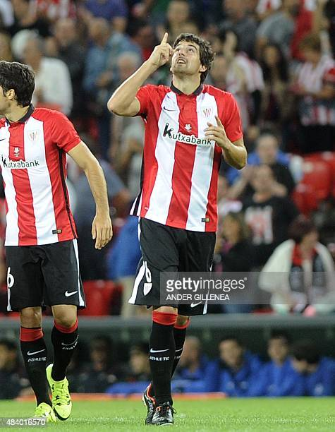 Athletic Bilbao's defender Mikel San Jose celebrates after scoring during the Spanish Supercup firstleg football match Athletic Club Bilbao vs FC...