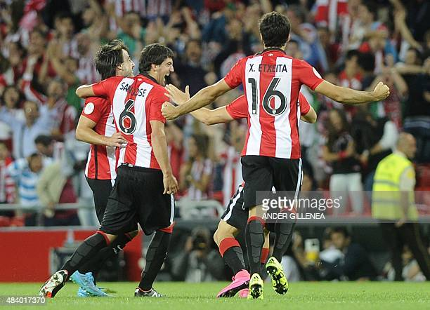 Athletic Bilbao's defender Mikel San Jose is congratulated by teammates midfielder Benat Etxebarria midfielder Oscar de Marcos and defender Xabier...