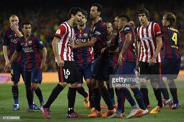 Athletic Bilbao's defender Xabier Etxeita clashes with Barcelona's Brazilian forward Neymar da Silva Santos Junior during the Spanish Copa del Rey...