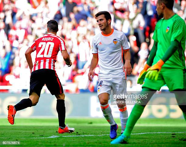 Athletic Bilbao's forward Aritz Aduriz celebrates after scoring his team's second goal during the Spanish league football match Athletic Club de...