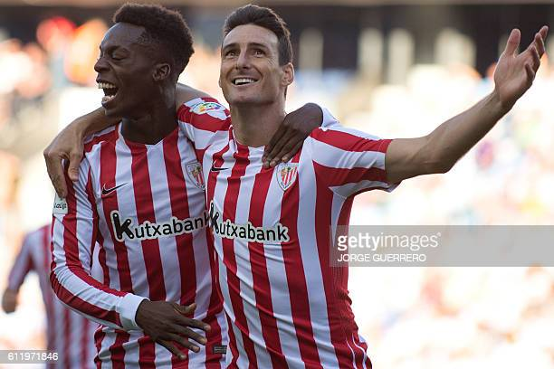 Athletic Bilbaos forward Aritz Aduriz celebrates after scoring with forward Inaki Williams during the Spanish league football match Malaga CF vs...