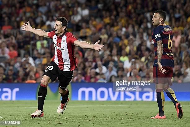 Athletic Bilbao's forward Aritz Aduriz celebrates his goal next to Barcelona's defender from Brazil Dani Alves during the Spanish Supercup secondleg...