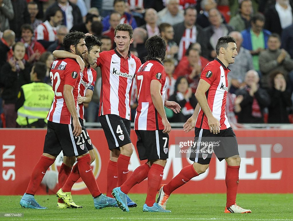 Athletic Bilbao's forward Aritz Aduriz celebrates with French defender Aymeric Laporte and teammates scoring during the UEFA Europa League group L...