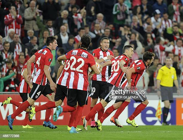 Athletic Bilbao's forward Aritz Aduriz celebrates with teammates after scoring during the UEFA Europa League group L football match Athletic Club...