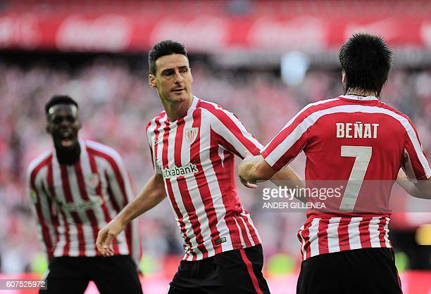 Athletic Bilbao's forward Aritz Aduriz celebrates with teammates after scoring during the Spanish league football match Athletic Club de Bilbao vs...
