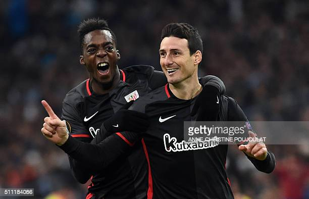 Athletic Bilbao's forward Aritz Aduriz celebrates with with Athletic Bilbao's forward Inaki Williams after scoring a goal during the UEFA Europa...