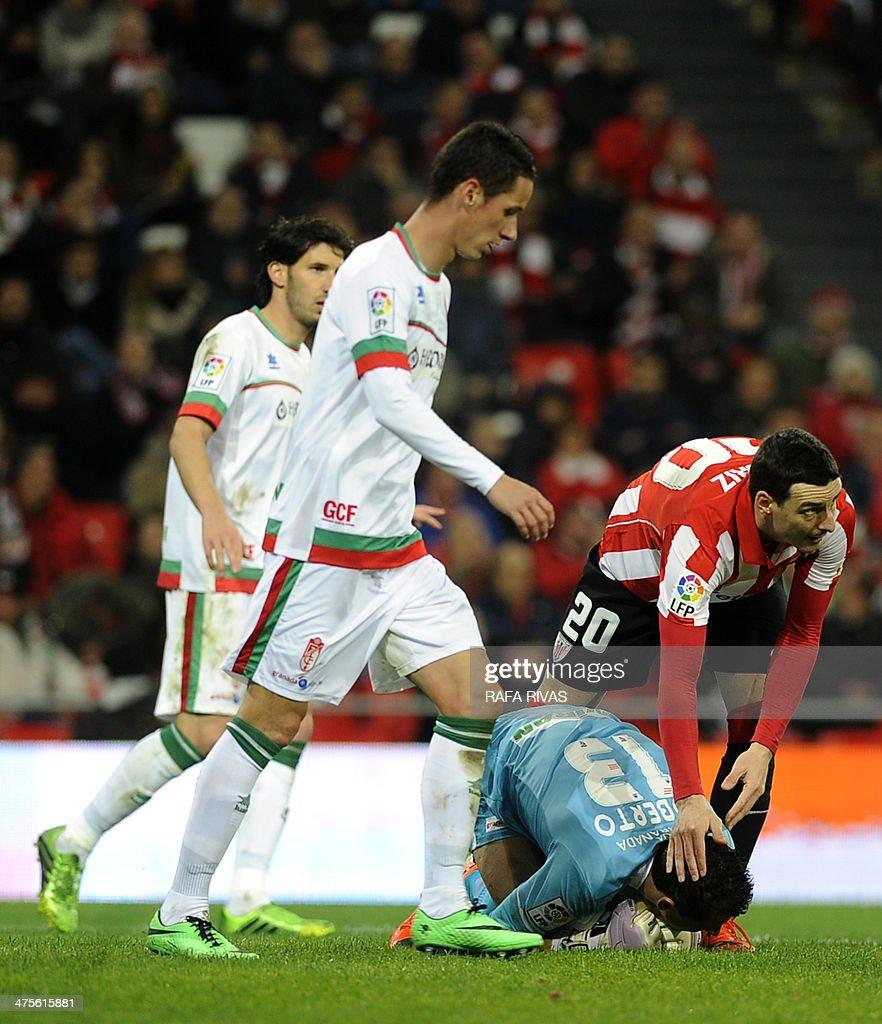 Athletic Bilbao's forward Aritz Aduriz congratulates Granada's goalkeeper Roberto Fernandez after he grabbed a ball during the Spanish league...